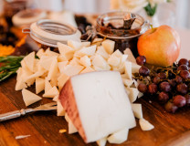 Rustic cheese display with honey and jam